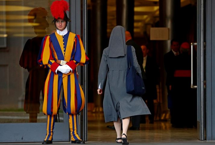 f954768360a5 FILE PHOTO: A nun enters to take part at the synod afternoon session led by  Pope Francis at the Vatican October 16, 2018. Picture taken October 16,  2018.